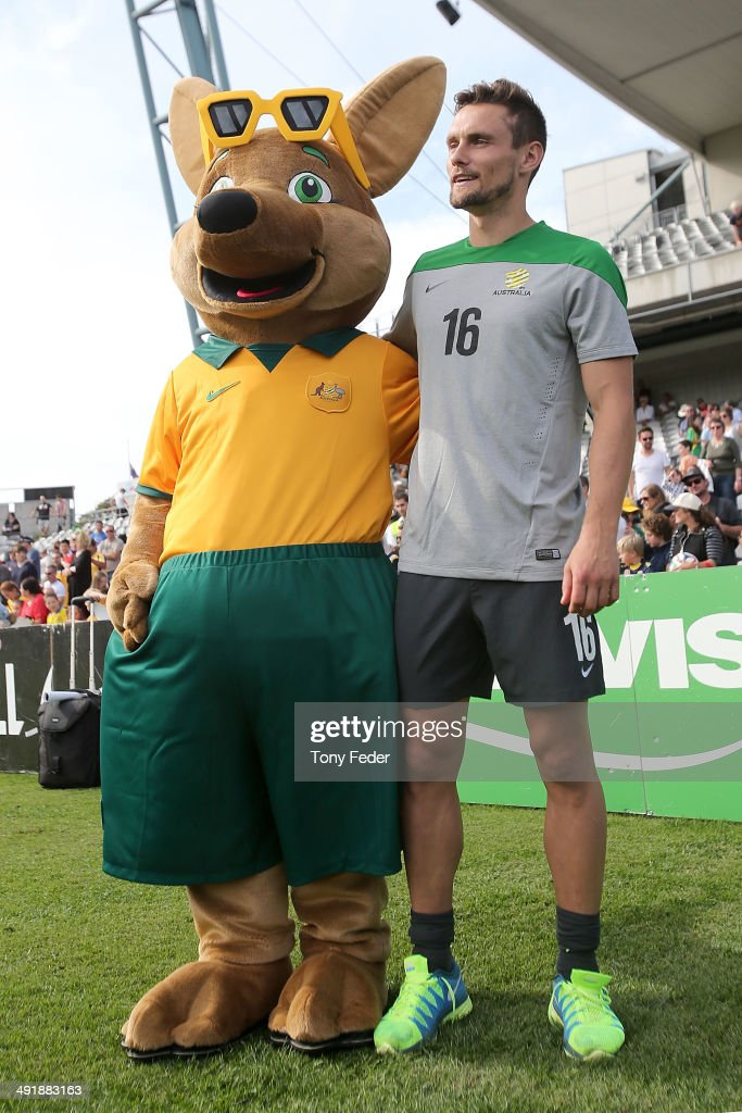 Maloo the Socceroos mascot poses with <a gi-track='captionPersonalityLinkClicked' href=/galleries/search?phrase=James+Holland&family=editorial&specificpeople=1647686 ng-click='$event.stopPropagation()'>James Holland</a> of the Socceroos during the Australian Socceroos Fan Day & Training Session at Bluetongue Stadium on May 18, 2014 in Gosford, Australia.