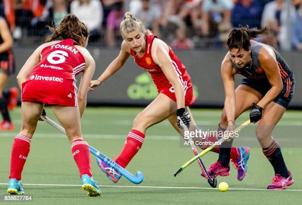 Malou Pheninckx of The Netherlands fights for the ball with Sarah Haycroft of England and Anna Toman of England during the women's EuroHockey...