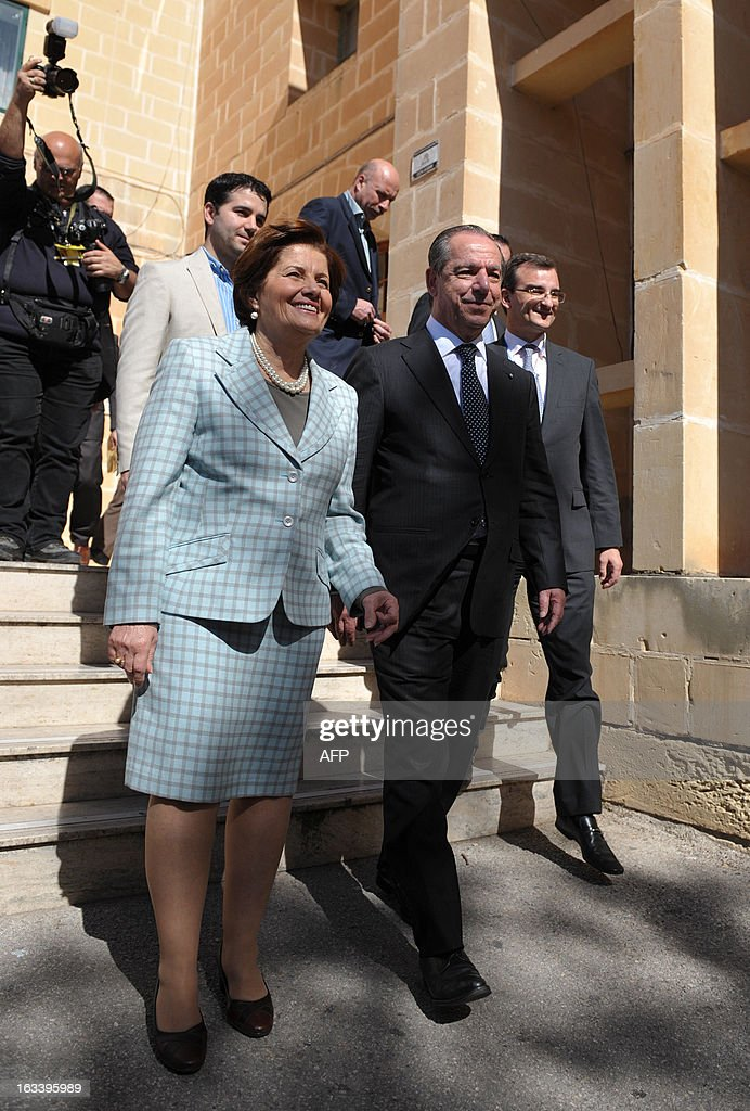 Malta Prime Minister and leader of the Nationalist Party Lawrence Gonzi and his wife Kate leave the Marsascala voting station during the National...