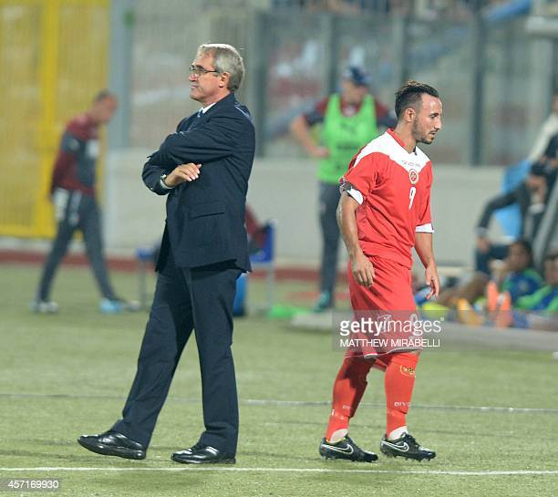 Malta's Michael Mifsud walks off the field passing Malta coach Pietro Ghedin after he receives a red card during the UEFA Euro 2016 Group H...