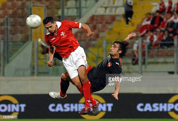 Malta's national football team defender Roderick Briffa fights for the ball with Austria's striker Sanel Kuljic 07 February 2007 in Valletta during...