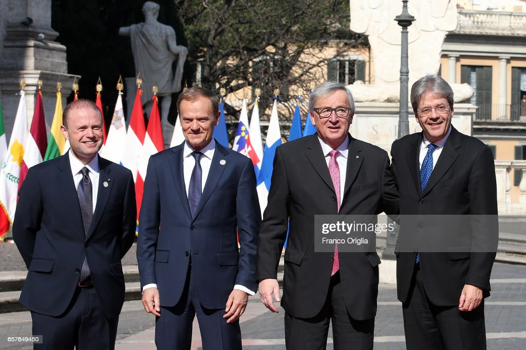 Malta's Prime Minister Joseph Muscat, European Council President Donald Tusk, Commission President Jean-Claude Juncker and Italy's Prime Minister Paolo Gentiloni pose for pictures at the Capitole Hill ahead of a special summit of EU leaders to mark the 60th anniversary of the bloc's founding Treaty of Rome on March 25, 2017 in Rome, Italy. The 60th anniversary of the signing of the treaties creating the European Economic Community and the European Atomic Energy Community the first major structural steps toward creating the European Union.