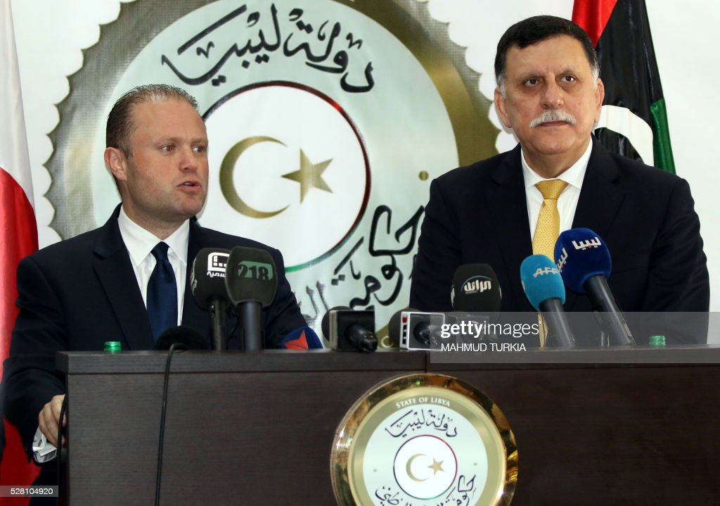 Malta's Prime minister Joseph Muscat (L) holds a press conference with Fayez al-Sarraj, prime minister of the UN-backed unity government, on May 4, 2016, at a naval base in the Libyan capital Tripoli where the GNA established its headquarters. / AFP / MAHMUD