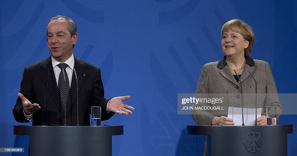 Malta's Prime Minister Lawrence Gonzi (L) gestures as he speaks during a press conference with German Chancellor Angela Merkel (R) , following talks at the chancellery in Berlin, Germany on January 9, 2013. AFP PHOTO / JOHN MACDOUGALL