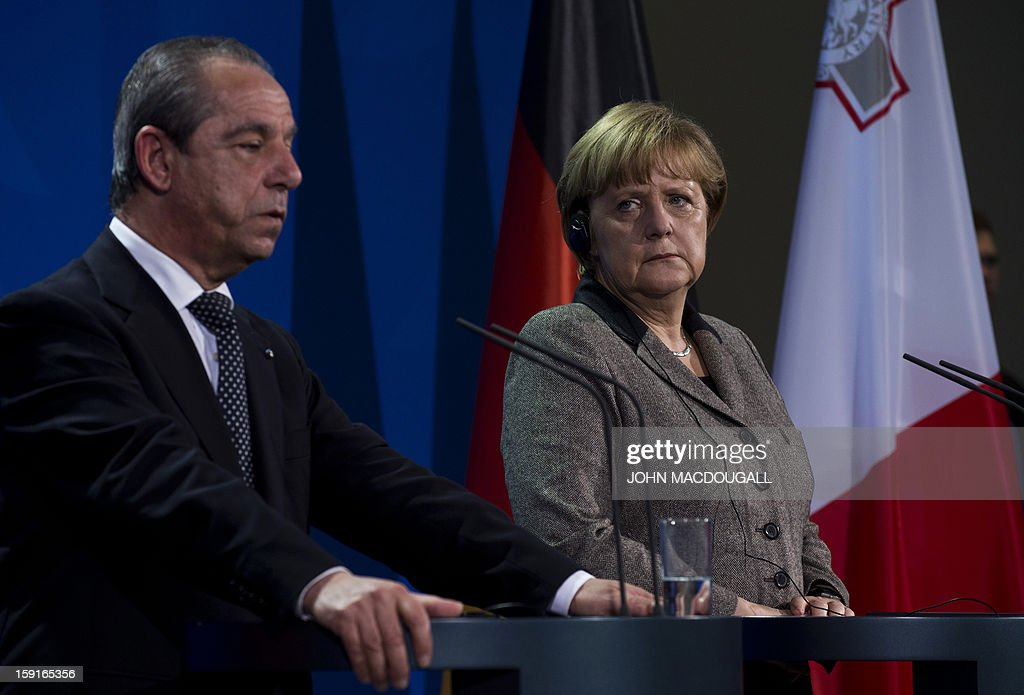 Malta's Prime Minister Lawrence Gonzi (L) speaks during a press conference with German Chancellor Angela Merkel (R) , following talks at the chancellery in Berlin, Germany on January 9, 2013. AFP PHOTO / JOHN MACDOUGALL