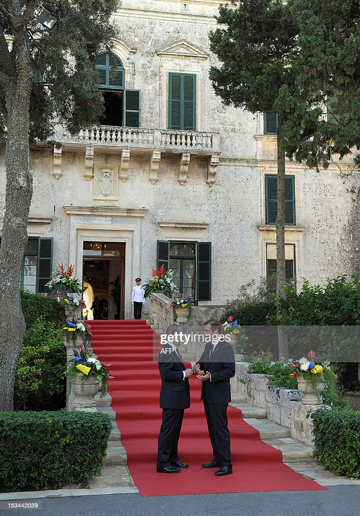 Malta's Prime Minister Lawrence Gonzi talks with his Portuguese counterpart Pedro Passos Coelho at the Verdala Palace before the first working...