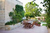 A traditional Mediterranean farmhouse garden in Malta, Europe with swimmingpool