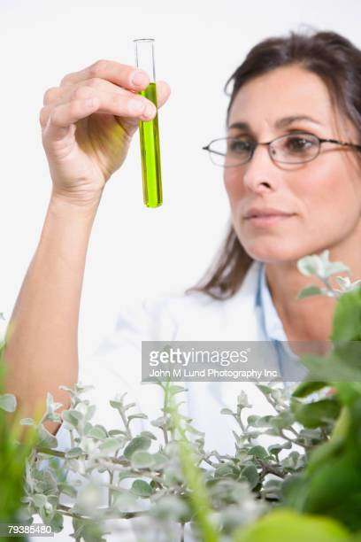 Maltese female scientist examining vial of liquid