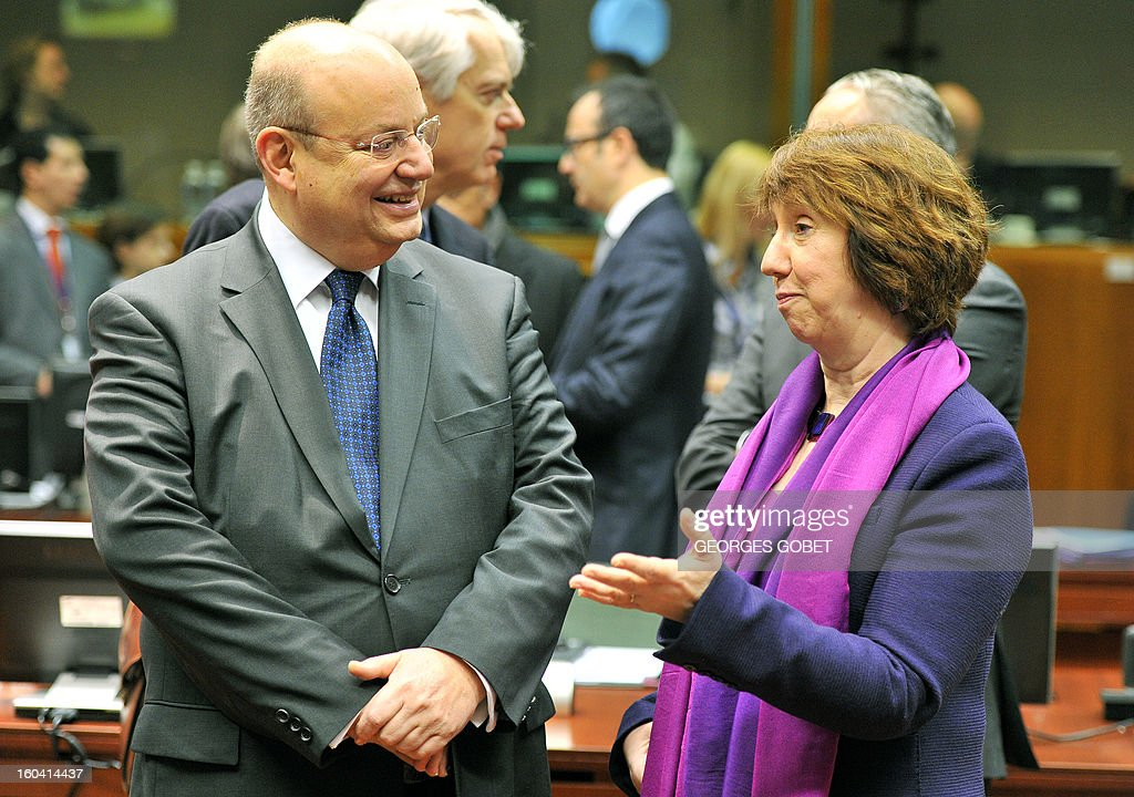 Maltese Foreign Affairs minister Francis Zammit Dimech and High Representative of the European Union for Foreign Affairs and Security Policy Catherine Ashton (LtR) talk priorto a Foreign Affairs Council on January 31, 2013 at the EU Headquarters in Brussels. The Council will discuss the situation in the EU's southern neighbourhood, in particular in Syria and Egypt, and will prepare the forthcoming European Council debate on the Arab Spring. Ministers will also discuss the priorities of the foreign policy of the new US administration.They will be informed of the situation in Mali and the action taken by the EU in response to the special session of the last Foreign Affairs Council devoted to Mali. AFP PHOTO GEORGES GOBET
