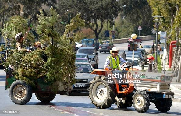 Maltese hunters parade to celebrate the result of the referendum on hunting on April 12 2015 in Rabat Malta has voted in a referendum to continue the...