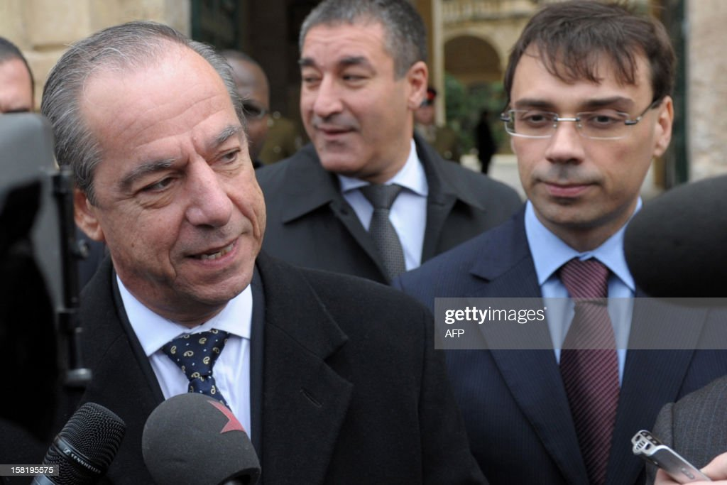 Maltese Prime Minister Lawrence Gonzi speaks to the press as he leaves after a meeting with the Maltese President, the day after the centre-left government lost its majority in parliament on December 11, 2012 in Valetta. Gonzi said the same day the parliament would be dissolved on January 7 ahead of the election following an agreement by both main political parties not to begin the election campaign during the Christmas season.
