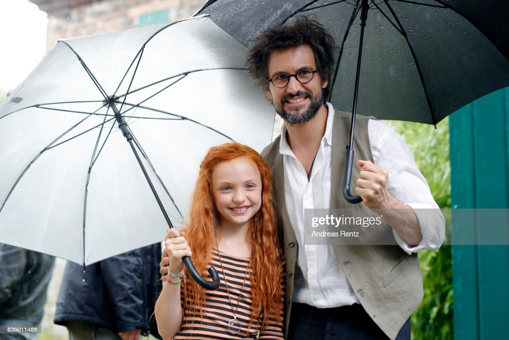 Malu Leicher and Tom Beck pose for photographs during a set visit of 'Liliane Susewind' on August 18, 2017 in Schleiden, Germany.