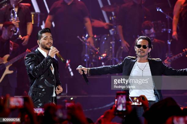 Maluma and Marc Anthony perform on stage during Univision's 'Premios Juventud' 2017 Celebrates The Hottest Musical Artists And Young Latinos...