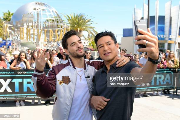 Maluma and Mario Lopez take a selfie at 'Extra' at Universal Studios Hollywood on March 28 2017 in Universal City California
