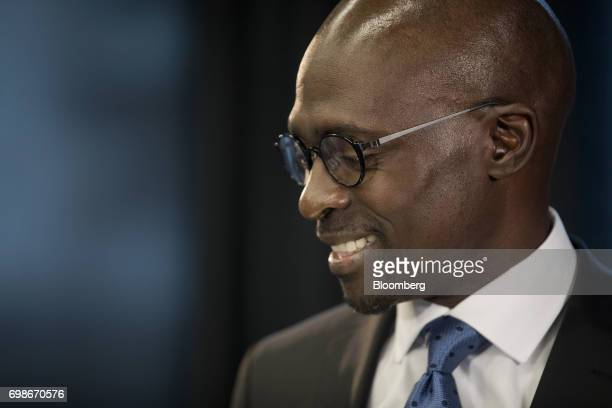 Malusi Gigaba South Africa's finance minister smiles during a Bloomberg Television interview in London UK on Tuesday June 20 2017 Business confidence...