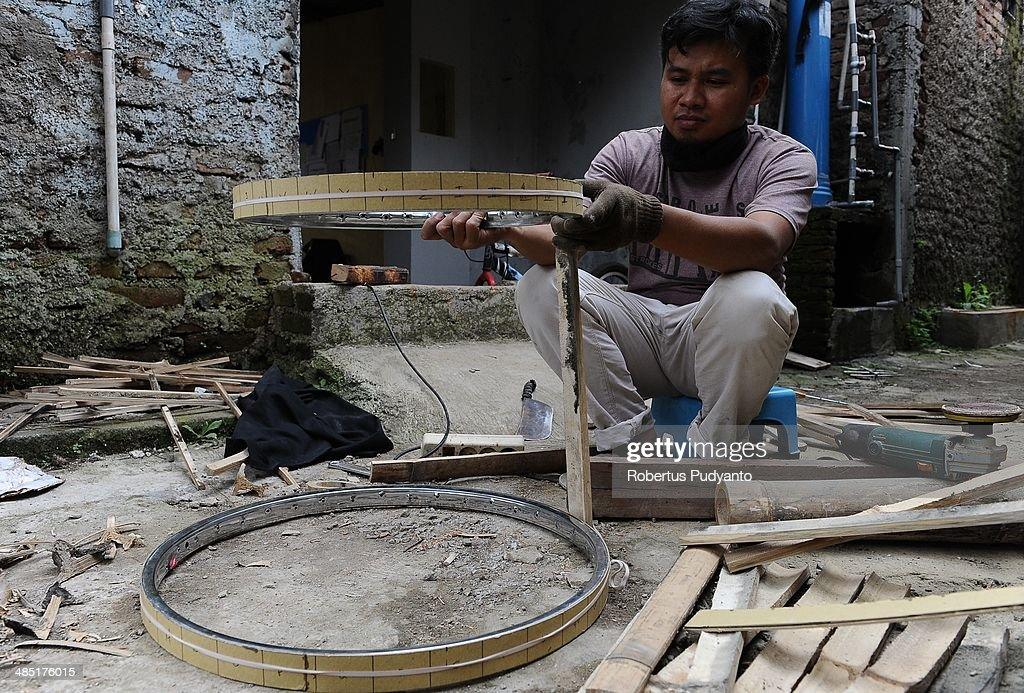 Malvino Purba Alam, 32, Head of Research Department in Indonesian Bamboo Community works to make a bamboo tympani at his workshop on April 17, 2014 in Bandung, Java, Indonesia. Adang Muhidin, founder of Indonesian Bamboo Community, and his friends make sustainable bamboo musical instruments (guitar, violin, bass, trumpet, clarinet, saxophone, drums) a nod to the rise of the creative economy in Indonesia.