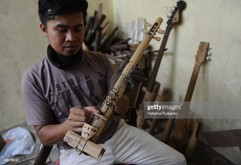 Malvino Purba Alam, 32, Head of Research Department in Indonesian Bamboo Community works to make a bamboo violin at his workshop on April 17, 2014 in Bandung, Java, Indonesia. Adang Muhidin, founder of Indonesian Bamboo Community, and his friends make sustainable bamboo musical instruments (guitar, violin, bass, trumpet, clarinet, saxophone, drums) a nod to the rise of the creative economy in Indonesia.