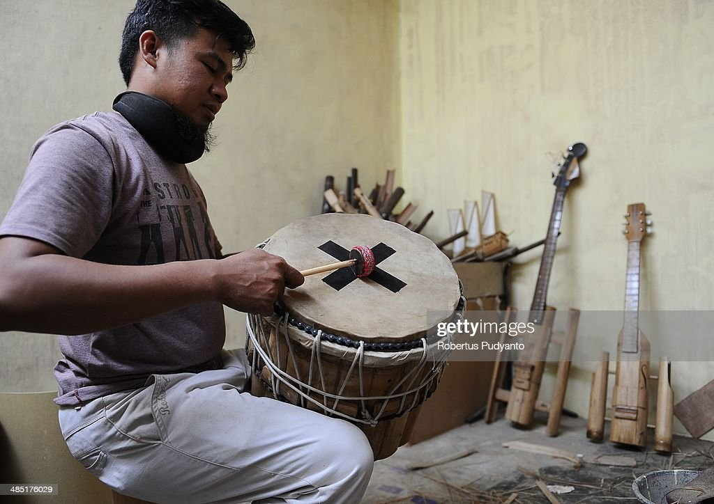 Malvino Purba Alam, 32, Head of Research Department in Indonesian Bamboo Community makes final inspection on a bamboo tympani at his workshop on April 17, 2014 in Bandung, Java, Indonesia. Adang Muhidin, founder of Indonesian Bamboo Community, and his friends make sustainable bamboo musical instruments (guitar, violin, bass, trumpet, clarinet, saxophone, drums) a nod to the rise of the creative economy in Indonesia.