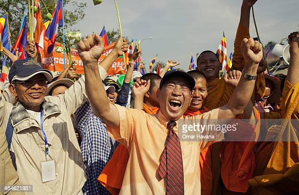 Mam Sonando a former Amnesty International prisoner of conscience celebrates his arrival at the Cambodian National Assembly following an extended 10...
