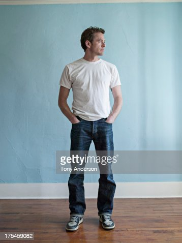 Mam standing in room at home