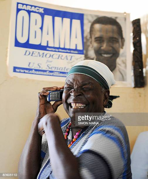 Mama Sarah Obama grandmother of US Democratic presidential candidate Barrack Obama laughs 29 August 2008 as she receives congratulatory messages at...