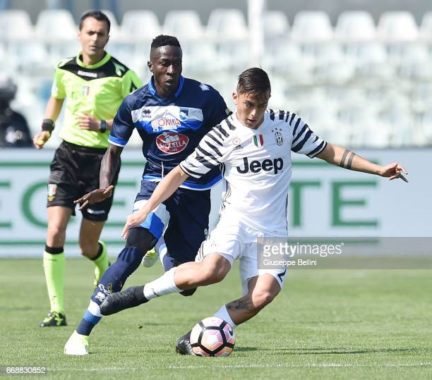 Mamadou Coulibaly of Pescara Calcio and Paulo Dybala of Juventus FC in action during the Serie A match between Pescara Calcio and Juventus FC at...