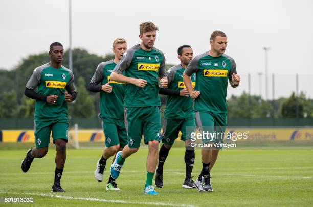 Mamadou Doucoure Christoph Kramer Marvin Schulz Tony Jantschke and Raffael run during a training session of Borussia Moenchengladbach at BorussiaPark...