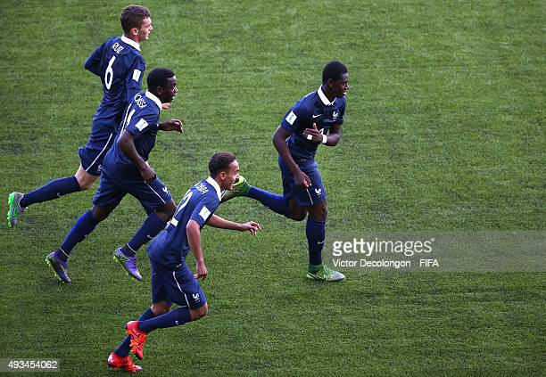Mamadou Doucoure Jean Ruiz Christ Maouassa and Bilal Boutobba of France run toward their team bench to celebrate Doucoure's goal against New Zealand...