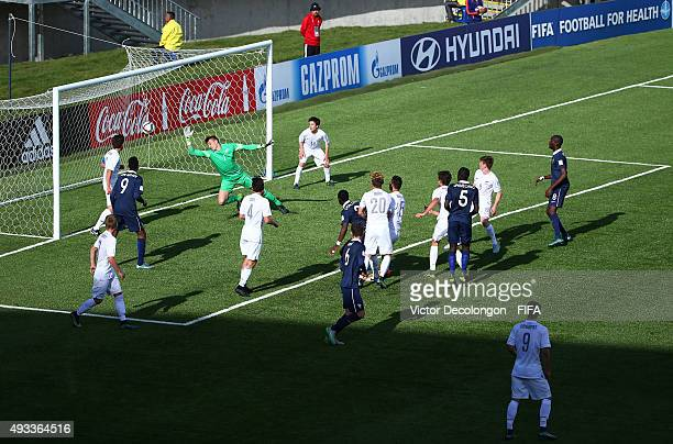 Mamadou Doucoure of France scores against goalkeeper Michael Woud of New Zealand during the New Zealand v France Group F FIFA 2015 U17 World Cup...