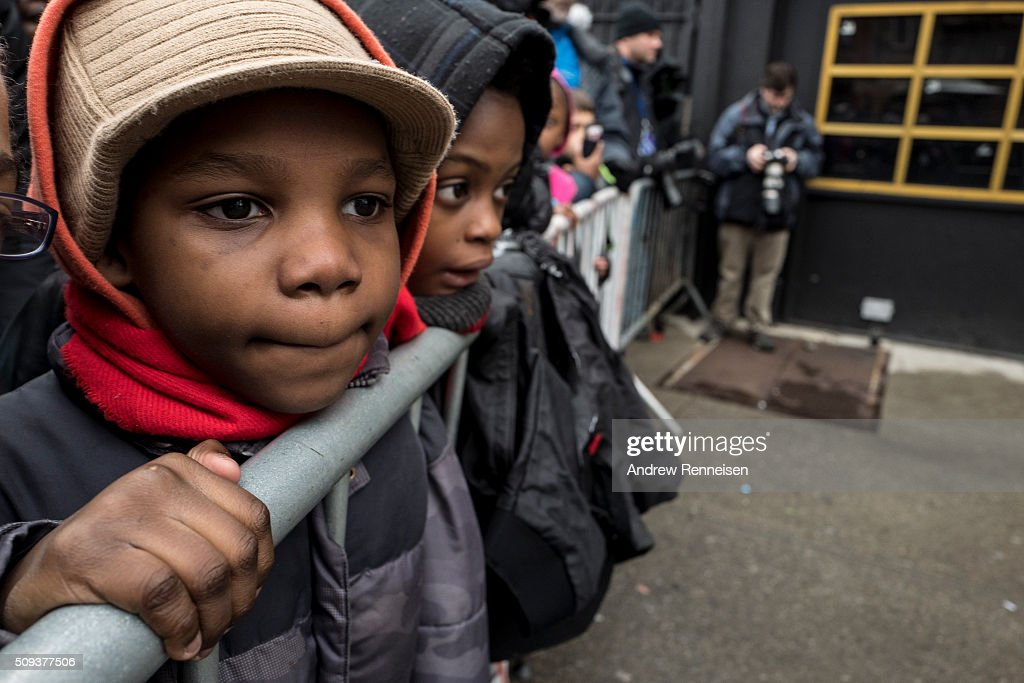 Mamadou Maiga, 9, from Harlem waits to see Democratic presidential candidate Sen. Bernie Sanders (D-VT) arrive for a meeting with Reverend Al Sharpton at Sylvia's Restaurant on February 10, 2016 in the Harlem neighborhood of New York City. The meeting comes after a strong victory for Senator Sanders in the New Hampshire primary.