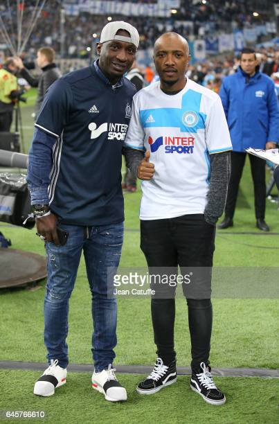 Mamadou Niang and Said M'Roumbaba aka Soprano attend the French Ligue 1 match between Olympique de Marseille and Paris Saint Germain at Stade...