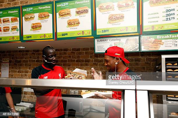 Mamadou Sakho and Jordan Ibe of Liverpool FC look at the sandwiches during meet and greet the fans at the Subway Cafe in Paradigm Mall on July 23...