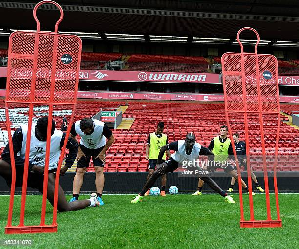 Mamadou Sakho and Kolo Toure of Liverpool in action during a training session at Anfield on August 8 2014 in Liverpool England