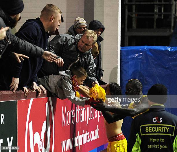 Mamadou Sakho and Lazar Markovic of Liverpool give their shirts to fans at the end of the Barclays Premier League match between Burnley and Liverpool...
