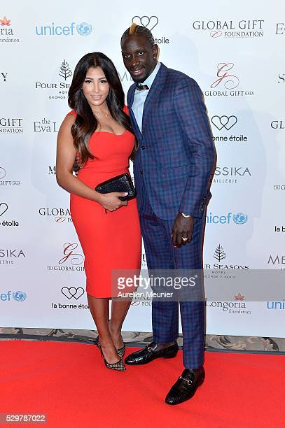 Mamadou Sakho and Madja Sakho attend the Global Gift Gala photocall at Four Seasons Hotel George V on May 9 2016 in Paris France