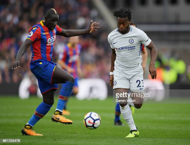 Mamadou Sakho of Crystal Palace and Michy Batshuayi of Chelsea compete for the ball during the Premier League match between Crystal Palace and...