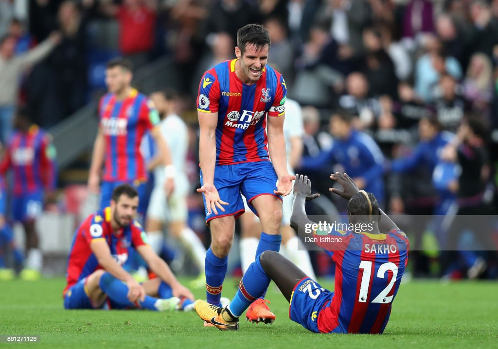 Mamadou Sakho of Crystal Palace and Scott Dann of Crystal Palace celebrate victory after the Premier League match between Crystal Palace and Chelsea at Selhurst Park on October 14, 2017 in London, England.