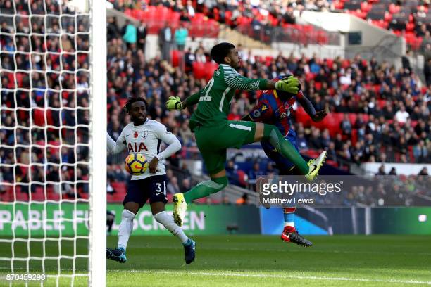 Mamadou Sakho of Crystal Palace attempts to head the ball as Paulo Gazzaniga of Tottenham Hotspur attempts to save during the Premier League match...