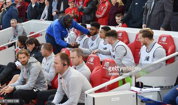 Mamadou Sakho of Crystal Palace says hello to his old team mates during the Premier League match between Liverpool and Crystal Palace at Anfield on...