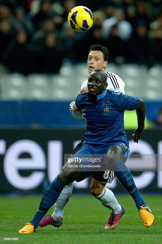 <a gi-track='captionPersonalityLinkClicked' href=/galleries/search?phrase=Mamadou+Sakho&family=editorial&specificpeople=4154099 ng-click='$event.stopPropagation()'>Mamadou Sakho</a> of France holds back <a gi-track='captionPersonalityLinkClicked' href=/galleries/search?phrase=Mesut+Oezil&family=editorial&specificpeople=764075 ng-click='$event.stopPropagation()'>Mesut Oezil</a> of Germany during the international friendly match between France and Germany at Stade de France on February 6, 2013 in Paris, France.