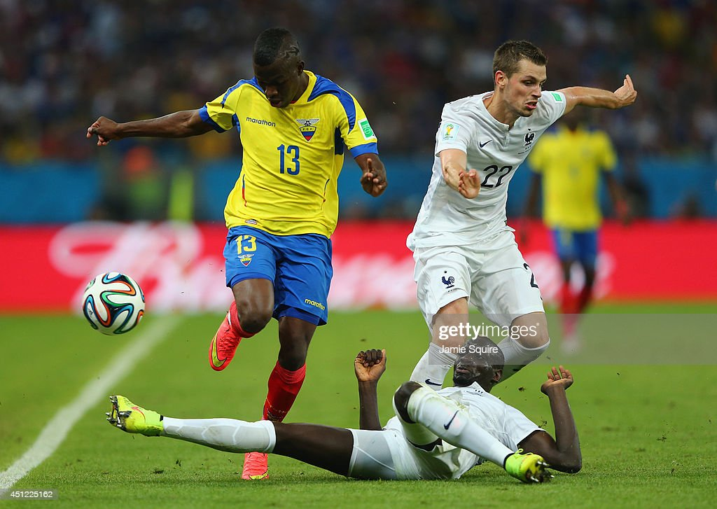 Mamadou Sakho of France tackles Enner Valencia of Ecuador during the 2014 FIFA World Cup Brazil Group E match between Ecuador and France at Maracana on June 25, 2014 in Rio de Janeiro, Brazil.