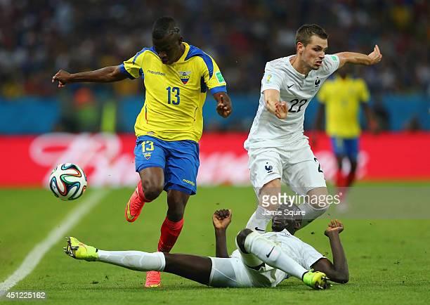 Mamadou Sakho of France tackles Enner Valencia of Ecuador during the 2014 FIFA World Cup Brazil Group E match between Ecuador and France at Maracana...