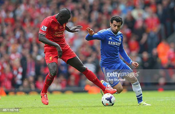 Mamadou Sakho of Liverpool and Mohamed Salah of Chelsea battle for the ball during the Barclays Premier League match between Liverpool and Chelsea at...