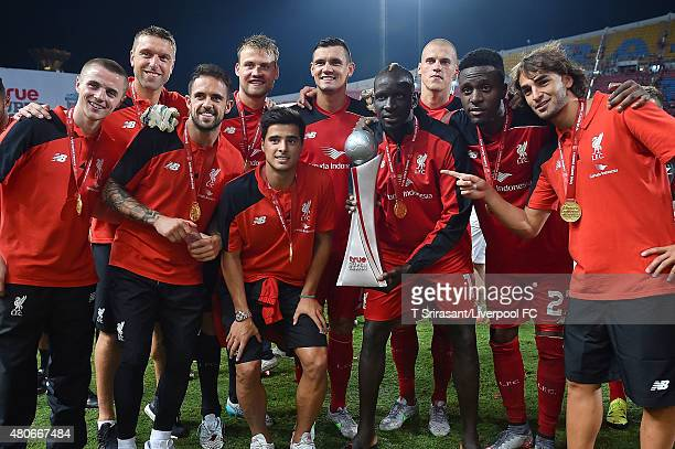 Mamadou Sakho of Liverpool and teammates lift the trophy after the international friendly match between Thai Premier League All Stars and Liverpool...