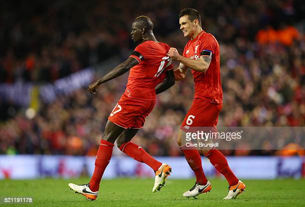 Mamadou Sakho of Liverpool celebrates scoring his team's third goal with Dejan Lovren during the UEFA Europa League quarter final second leg match...