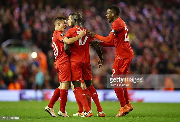 Mamadou Sakho of Liverpool celebrates scoring his team's third goal with Philippe Coutinho during the UEFA Europa League quarter final second leg...
