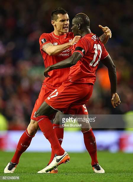 Mamadou Sakho of Liverpool celebrates scoring his team's third goal with Dejan Lovren during the UEFA Europa League quarter final second leg match...
