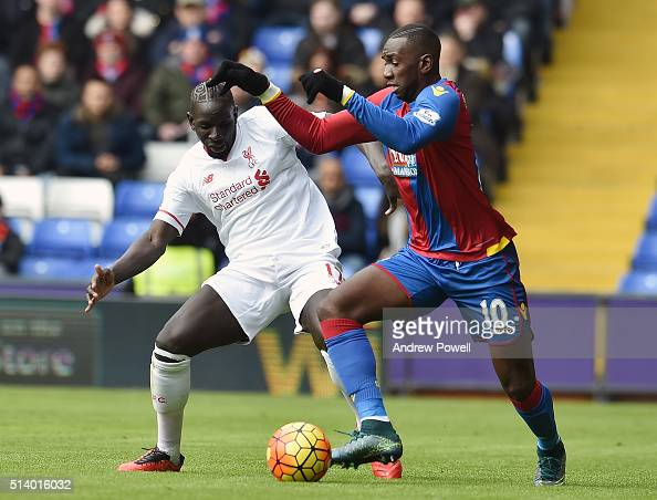 Mamadou Sakho of Liverpool competes with Yannick Bolasie of Crystal Palace during the Barclays Premier League match between Crystal Palace and...