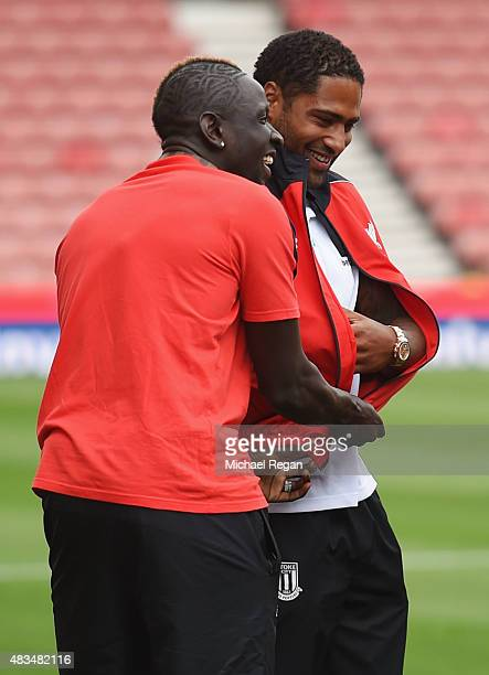 Mamadou Sakho of Liverpool dresses exLiverpool player Glen Johnson of Stoke City in a Liverpool tracksuit top prior to the Barclays Premier League...