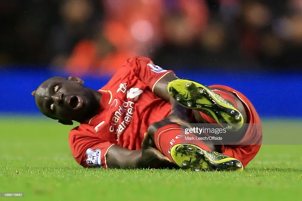 Mamadou Sakho of Liverpool goes down injured during the Barclays Premier League match between Liverpool and Crystal Palace at Anfield on November 8, 2015 in Liverpool, England.